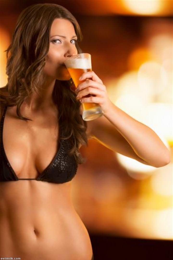 Emily ratajkowski drinks a beer after wearing string bikini